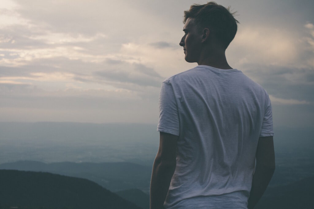 Man standing looking out at horizon