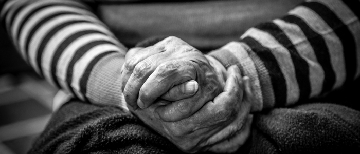 elderly person hands held together