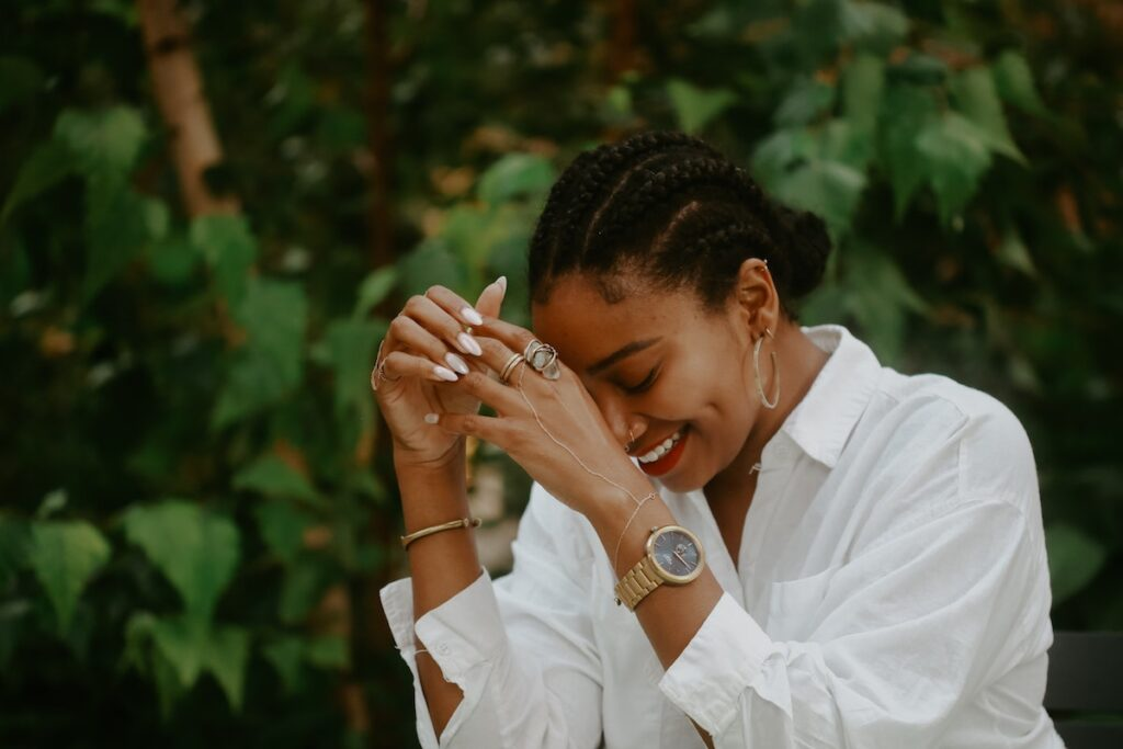 Photograph of a young black woman laughing