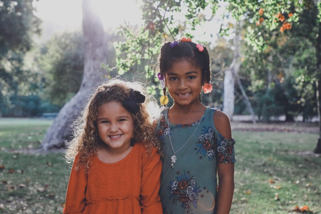 Two young girls dressed up in the garden
