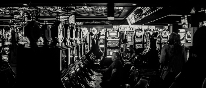man at slot machines gambling