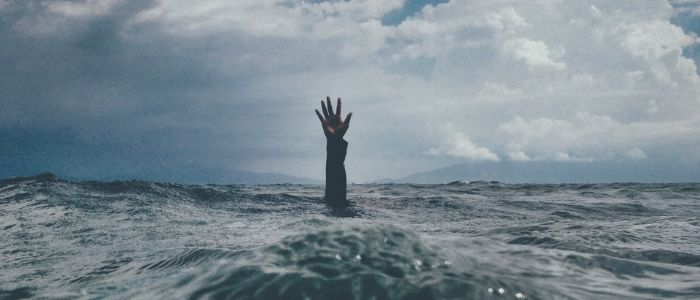 Arm reaching out of water - hypnotherapy for stress