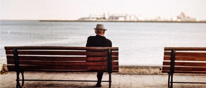 Elderly man sat on bench