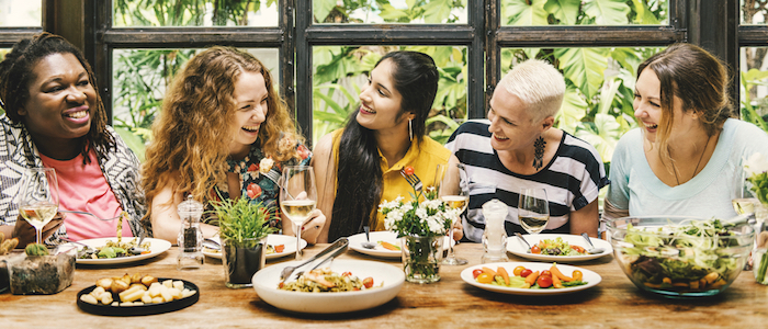 Women eating together and laughing