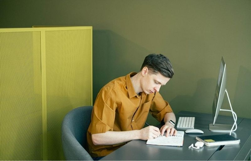 Image of a young man working at a desk