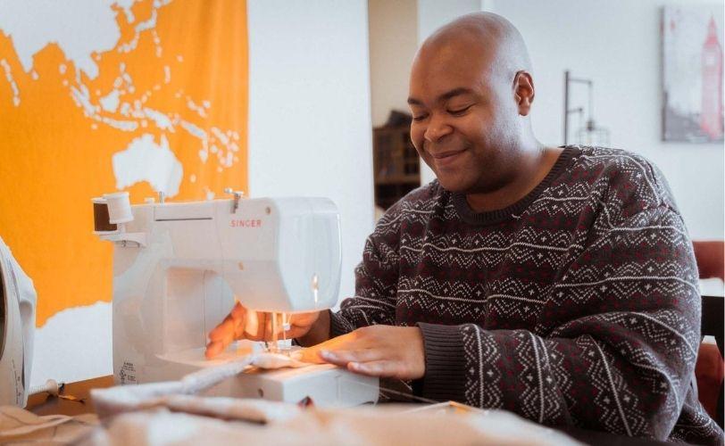 man-at-sewing-machine