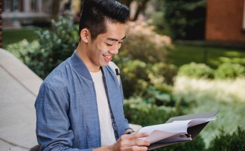 smiling man looking at papers