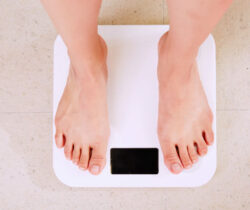 Obesity Awareness Week - Person barefoot standing on scales
