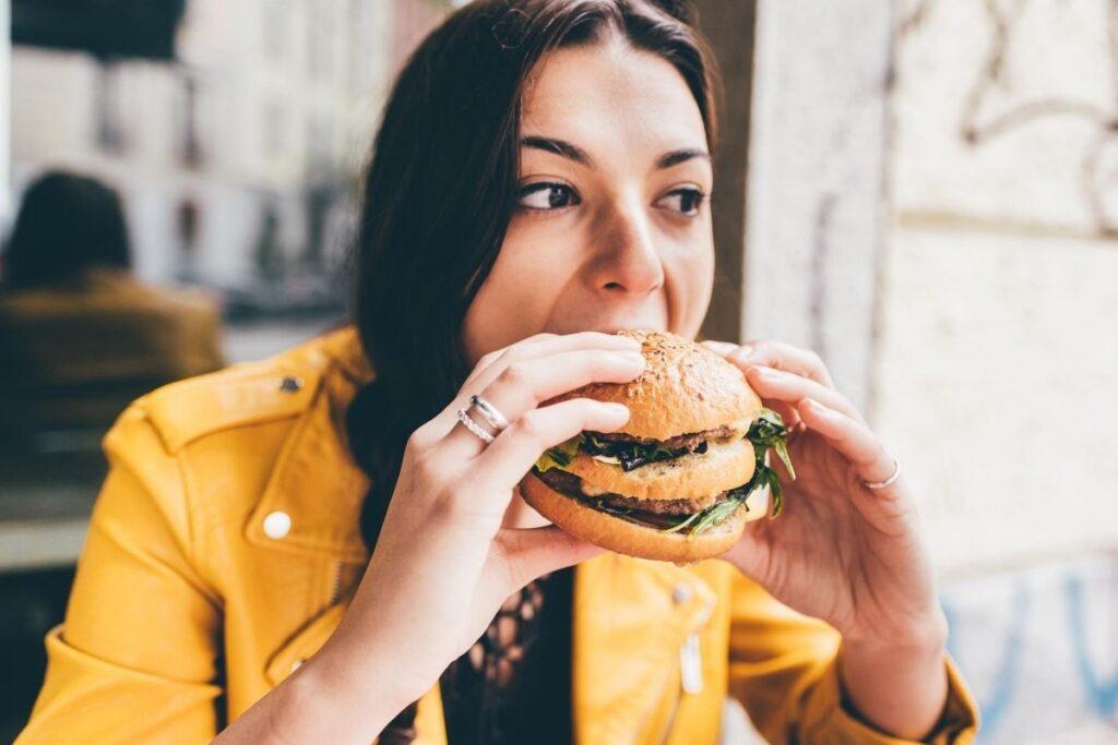 Woman eating burger