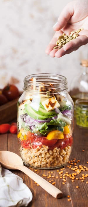 a close-up of a jar of vegetables, seeds and lentils