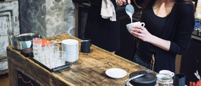 woman pouring milk into coffee - weight gain
