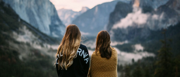 Two women looking towards mountains