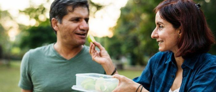 Woman and man having a picnic
