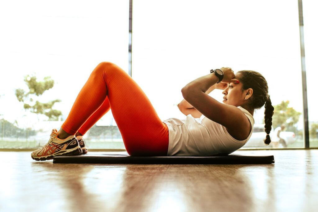 Woman in gym doing crunch