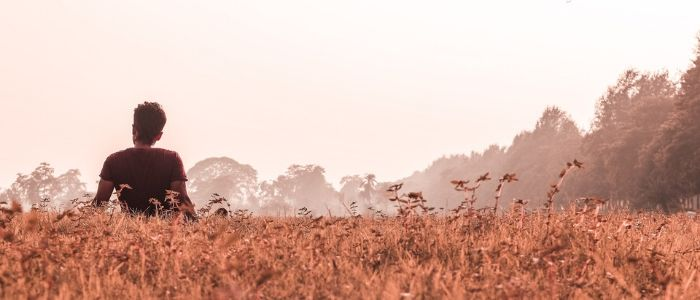 Man alone in field