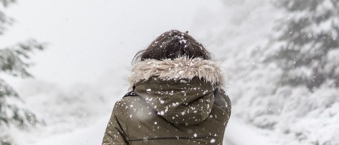 Person standing in the snow