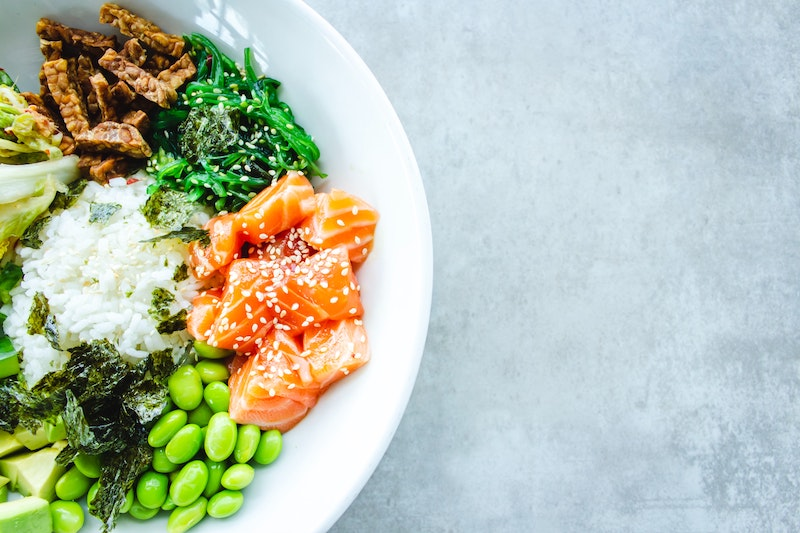 Image of a colourful Poke bowl of beans, kale and salmon