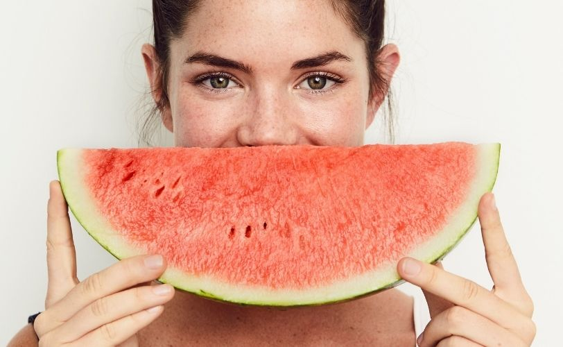 Lady smiling with watermelon