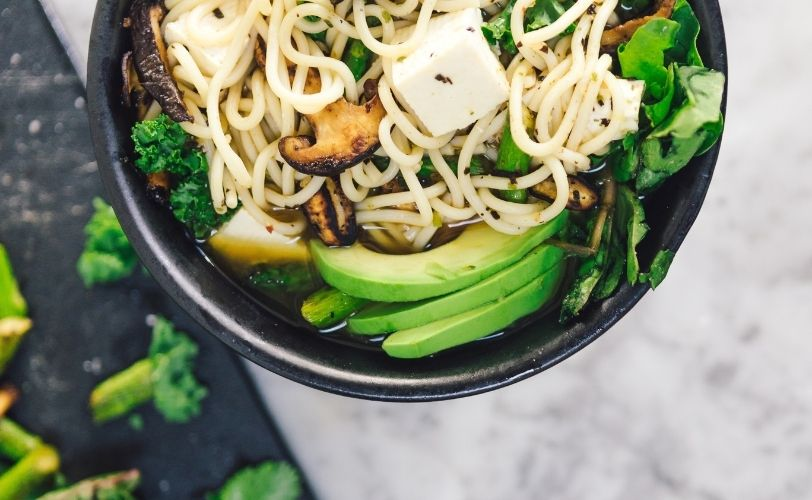 Avocado, tofu and noodles in a dish