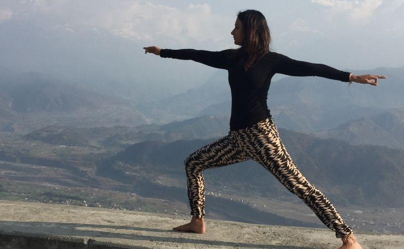 Richa Puri doing a yoga pose on the mountain