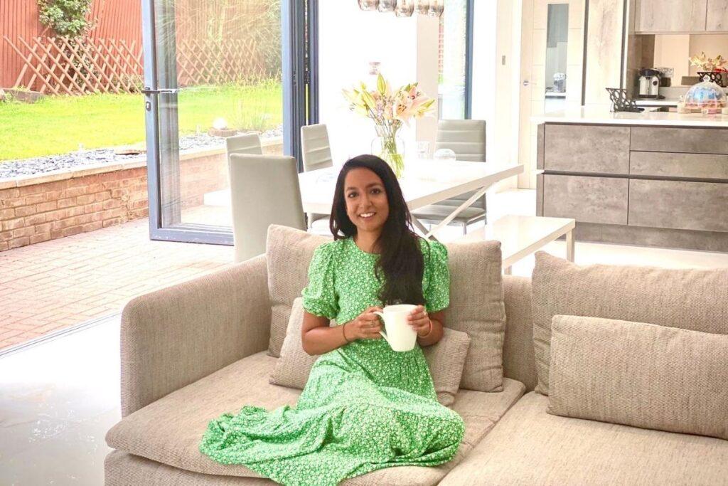 Richa Puri sitting on the sofa