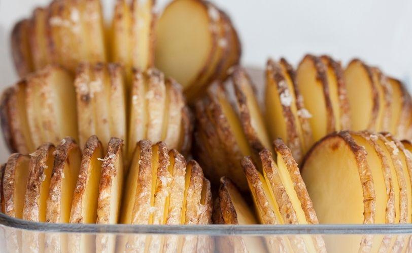 Hasselback potatoes in glass dish