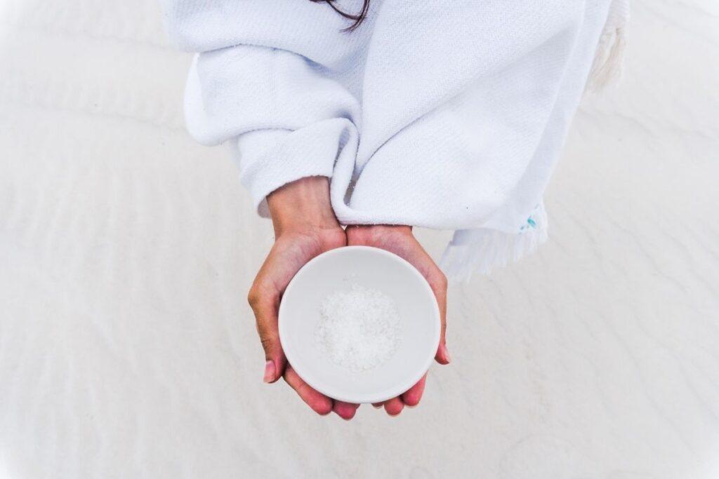 Woman holding bowl of salt