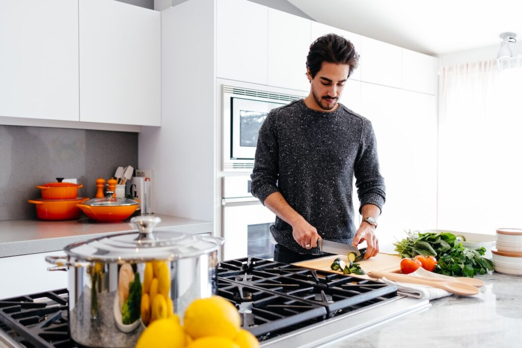 Man in kitchen cooking