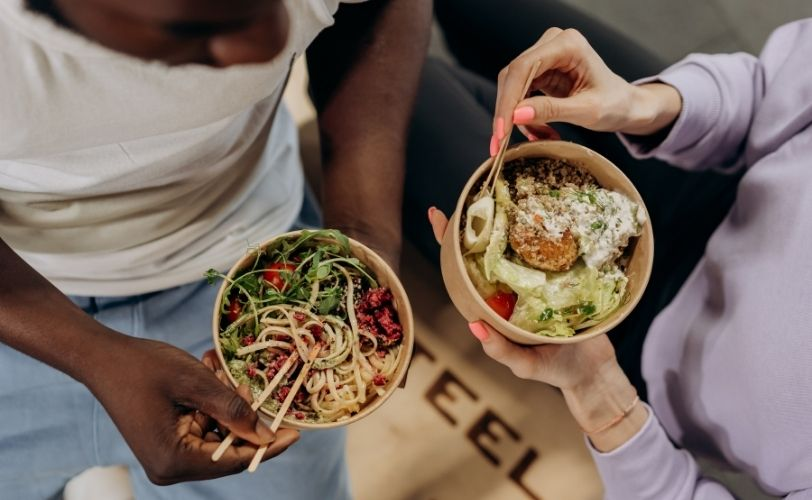 Two people eating from bowls