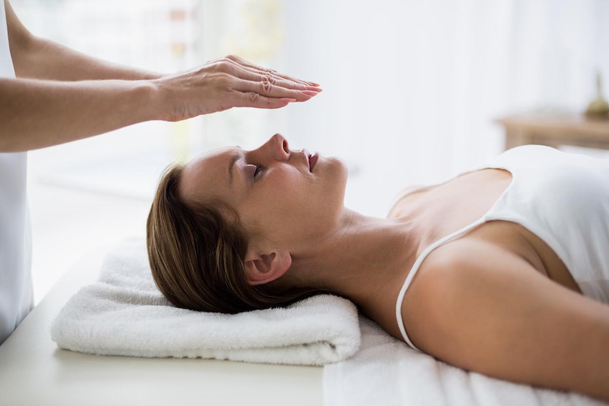 Woman having energy healing session
