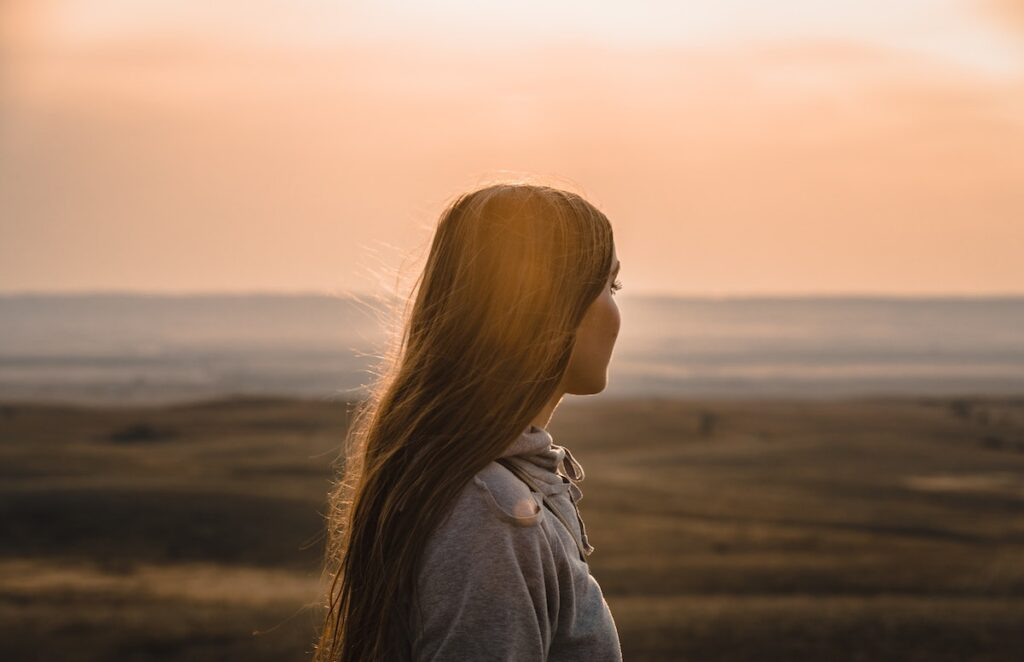 Image of a Girl Looking Out into the Sunset