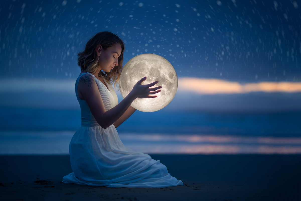 Woman holding the moon