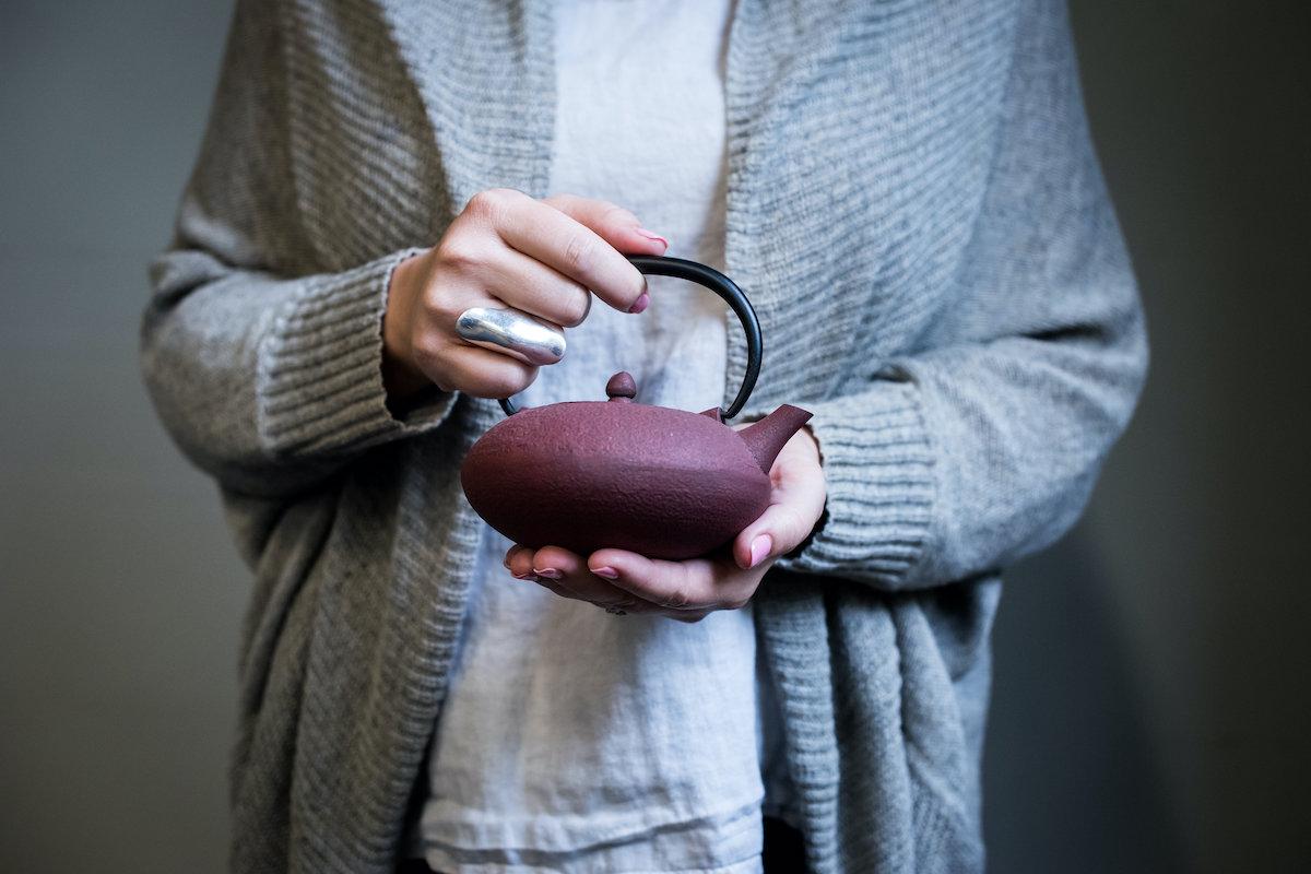 Beth Kempton holding a tea pot