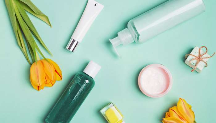 Skincare products on turquoise background