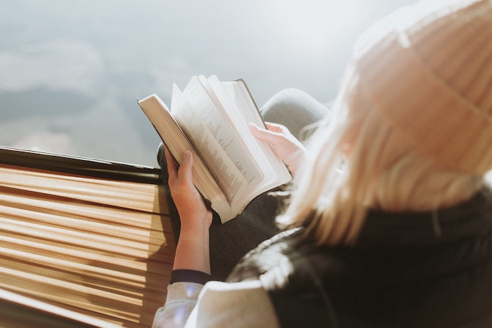 Woman Sat Outside Reading a Book