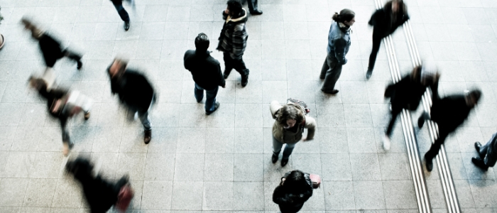 A blurred photo of a crowd at a station from above