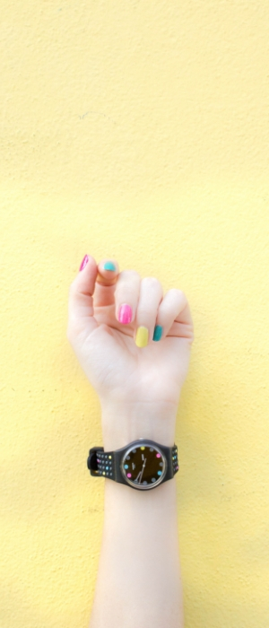 A hand with colourful nails