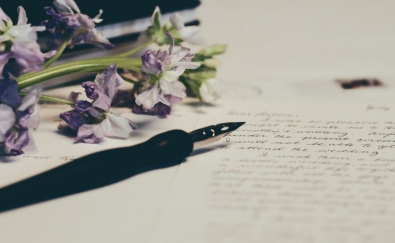 Fountain pen placed on paper with flowers