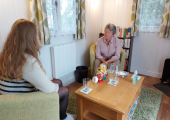 Image of a young woman sitting opposite me in my counselling room (client posed family member)