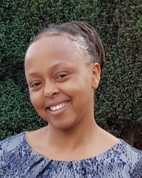 Wanjiru Macharia -  MSc, BA Hons, Adv Dip.