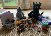 A selection of creative material and toys.