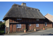 Tithe Cottage<br />Late 16th century timber frame thatch cottage.
