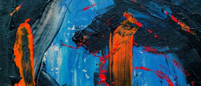 Close-up of a canvas, with random strokes of blue paint in various shades