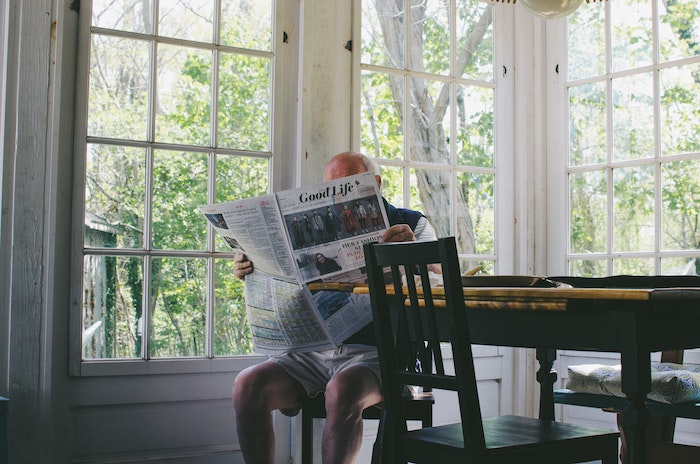 Older gentleman reading the paper