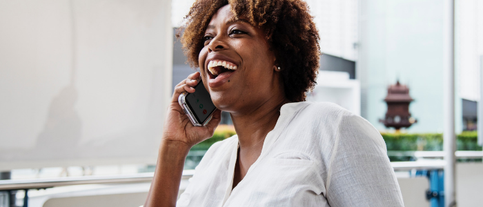 woman laughing while on the telephone