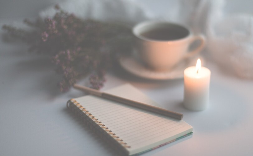 Candle and notepad