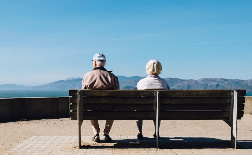 Image of an elderly couple on a bench