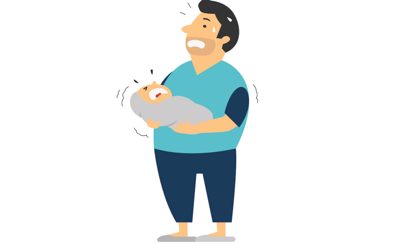 New dad holding baby