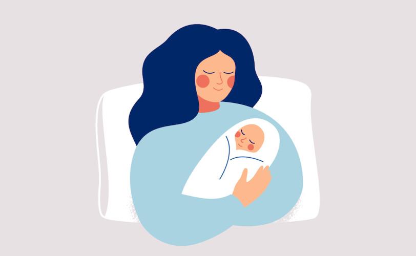 New mum holding baby