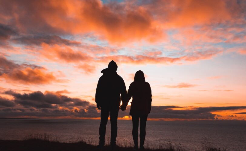 Silhouette of young couple against sunset